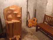 Corner of an old wine-cellar in Stio Cilento (Salerno - Italy) - exhibition of sculptures and guitars