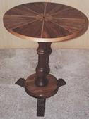 Round table in walnut with marquetry