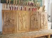 Panels made of chestnut wood with bas-relief: 'Ninna nanna contadina' (Peasant lullaby), 'Rinascere' (Revice), 'Cilento senza parole' (Cilento without words) and 'Tralcio di vite' (Vine shoot)