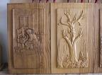 Carved panels made of chestnut wood, bas-reliefs 'Ninna nanna contadina' (Peasant lullaby) and 'Rinascere' (Revice)