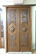 Front door with bas-reliefs 'Le quattro stagioni' (The Four Seasons) - Bas-reliefs on a panel of chestnut wood