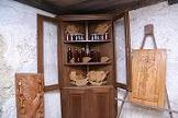 Corner cupboard in walnut with exhibition of sculptures: on the left 'Illusione della liberta' (Illusion of freedom) in mulberry wood and on the right 'Tralcio di vite' (Vine shoot) in chestnut wood