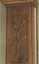 Bas-relief on a panel of chestnut wood