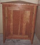 Corner cupboard in cherry wood