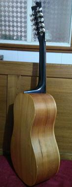 Chitarra battente (finished in 2016), sides in cherry wood, back plate in flowering ash (fraxinus ornus),                                      soundboard in fir wood retrieved from a piece of antique furniture 100 years old,                                      fingerboard in walnut, handle in chestnut. Shellac coating.
